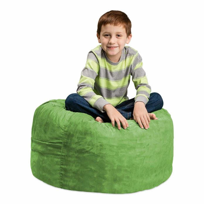 This is an image of a boy sitting on a Chill Sack Bean Bag Chair