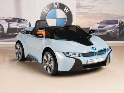 This is an image of kids bmw wheels car with remote control in blue and black color