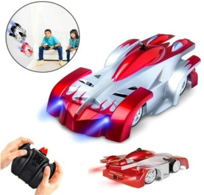 This is an image of toddler climbing remote control car in red and white color