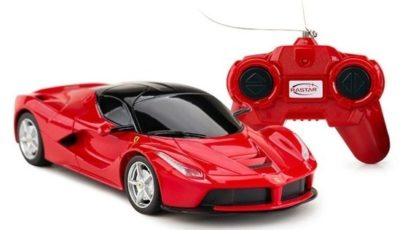 This is an image of toddler ferrari in red with remote control car