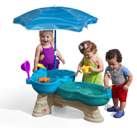 This is an image of a children playing with a water table.