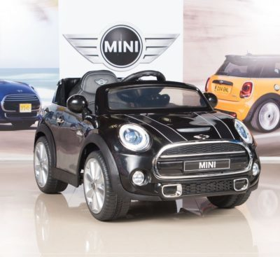 This is an image of kids mini cooper kids electric ride on car with remote control in black color