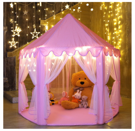 This is an image of a pink castle tent with stuffed toys.