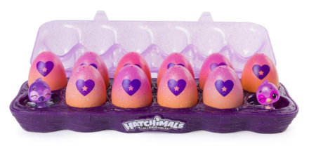 This is an image of a purple egg tray with collectible toys.