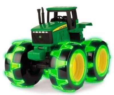 This is an image of kids tractor with lights in wheels in green color by jon deere
