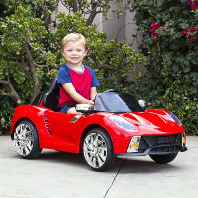 This is an image of kids battery powered remote control car in red color