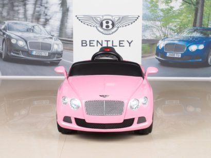 This is an image of kids girl powered car in pink color