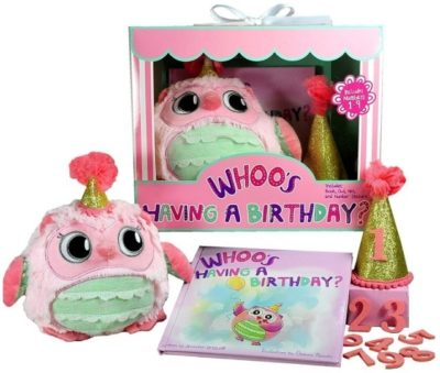 This is an image of baby girl owl set birthday with book and owl plush in pink color