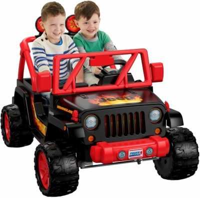 This is an image of kids power wheels tough talking jeep in red and black colors