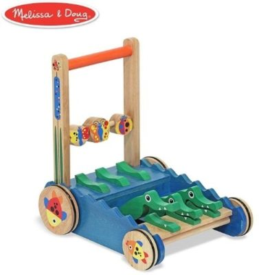This is an image of baby wooden walker in blue color has green crocodiles