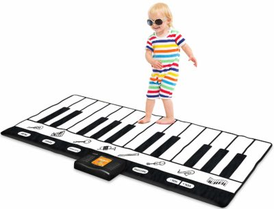 This is an image of a kid playing with a 71 inch keyboard mat.