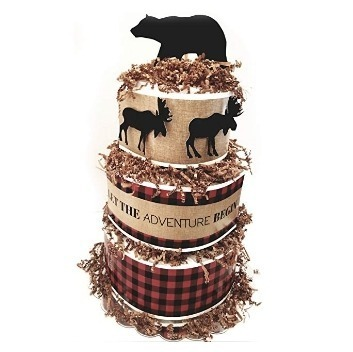 This is an image of boys diaper cake with a black bear plush