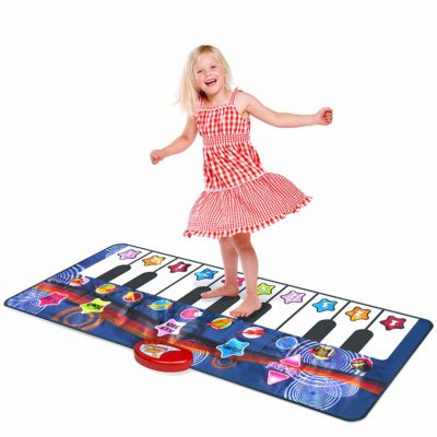 This is an image of a little girl using a dance and learn piano play mat.