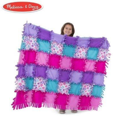 This is an image of girl's flower fleece quilt in colorful colors by melissa and doug