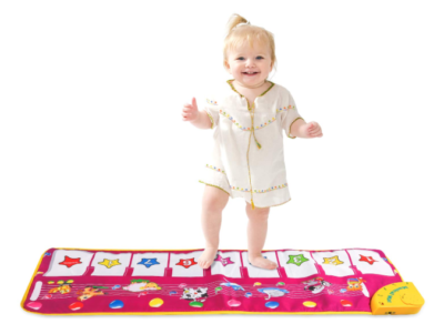 This is an image of a toddler playing with a purple piano play mat.