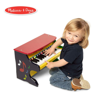 This is an image of a child playing with a colorful musical piano.