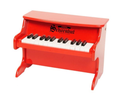 This is an image of a 25 key red piano for kids.
