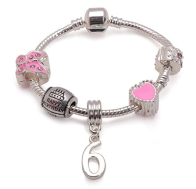 This is an image of a pink bracelet for a 6 year old birthday celebrant.