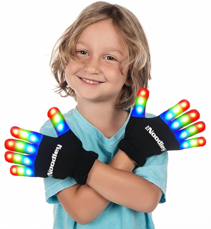 9 year old boy looking at camera wearing toy gloves